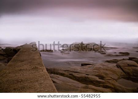 Foggy evening at elba island in winter - stock photo