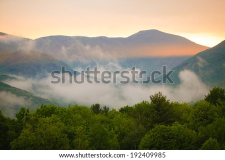 Foggy evening sunset in the mountains of Stowe, Vermont, USA - stock photo