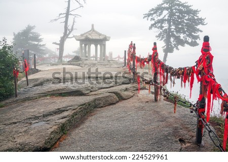 Foggy fabulous atmosphere with Chinese style gazebo in Huashan mountains, China.  Canon5D MkII. - stock photo