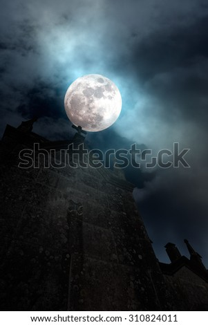 Foggy full moon over old cemetery - stock photo
