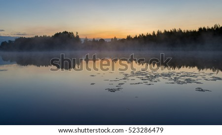 Foggy lake in the morning, Belarus, Summer