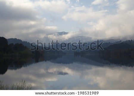 Foggy landscape in a lake - stock photo