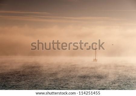 Foggy morning at Swanage ,England - stock photo