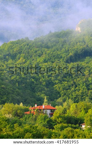 Foggy morning in the mountain village in Bulgaria - stock photo