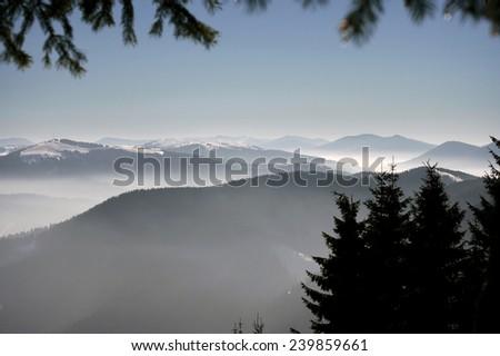 Foggy morning mountains - stock photo