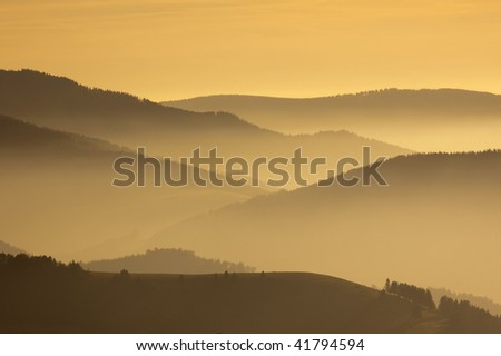 Foggy morning on the mountains - stock photo