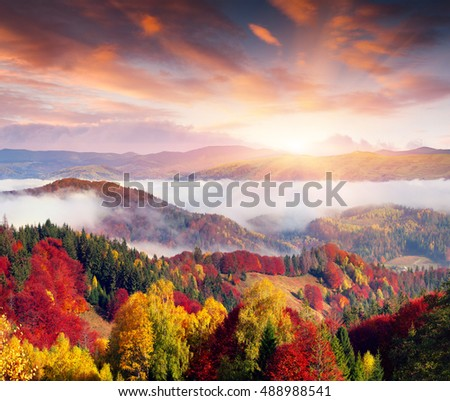 Foggy morning scene in the mountain village. Colorful autumn sunrise in the Carpathian mountains, Ukraine, Europe. Artistic style post processed photo.