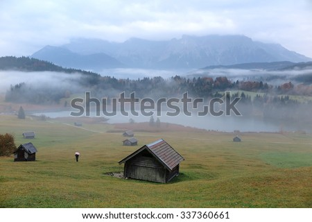 Foggy morning scenery of Lake Geroldsee in autumn, an alpine lake between Garmisch-Partenkirchen and Mittenwald with Karwendel mountains in the background, Gerold, Bavaria, Germany - stock photo