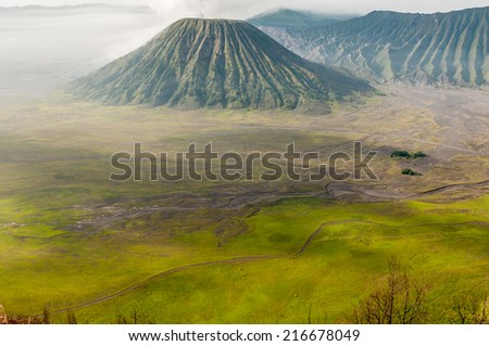 Foggy morning view of Bromo volcano at sunrise,, Java, Indonesia - stock photo