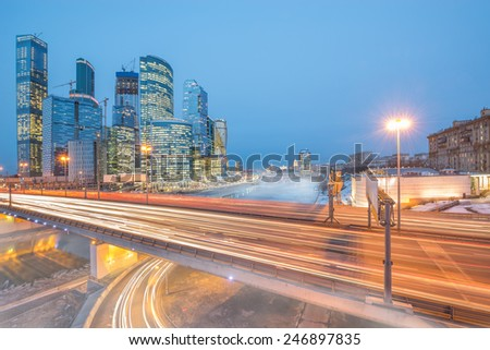 Foggy morning view of the bridge and business city center by the river.  - stock photo