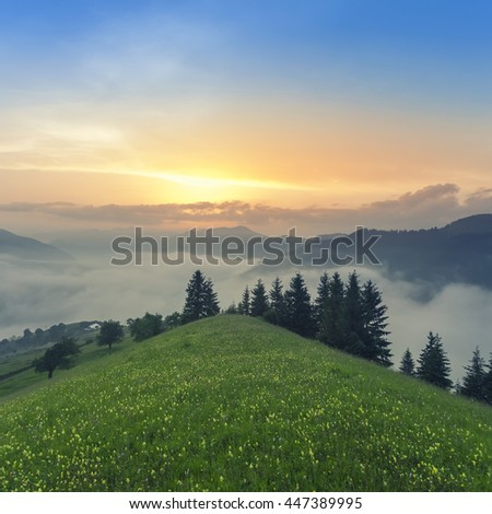 Foggy mountain landscape under morning sky. Carpathian mountains, Ukraine.