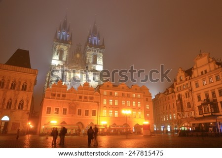 Foggy night on the Old Town main square and Gothic building of the Church of Our Lady before Tyn, Prague Old Town, Czech Republic - stock photo