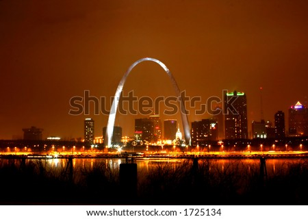 Foggy night view of St. Louis skyline - stock photo
