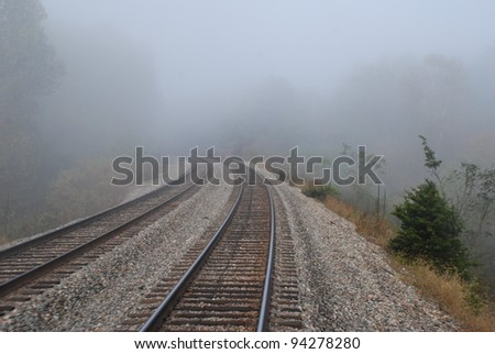 Foggy railroad - stock photo