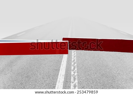 foggy road closed with red barriers - stock photo