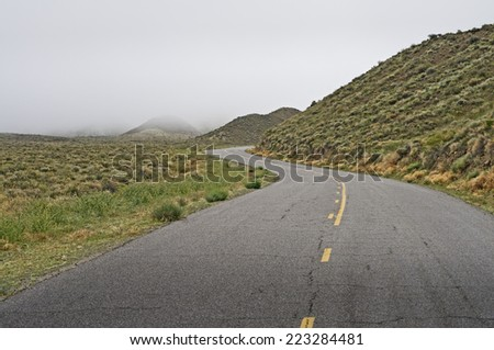 Foggy road in Death Valley National Park, California - stock photo