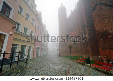 Foggy scenery of Kwidzyn castle and cathedral, Poland - stock photo