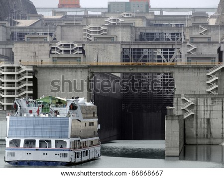 foggy scenery with ferry in front of the Three Gorges Dam at Yangtze River in China - stock photo