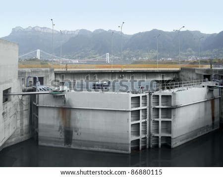 foggy sceneryshowing a detail of the Three Gorges Dam at Yangtze River in China - stock photo