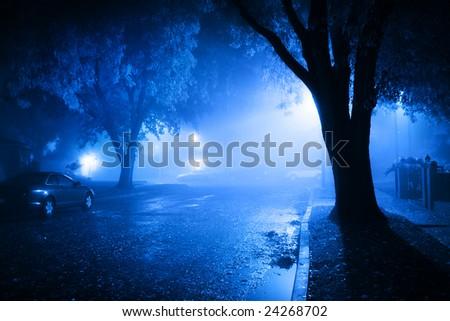 Foggy street at night - stock photo