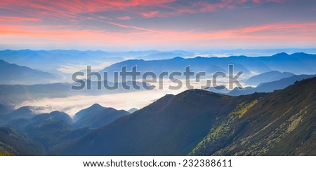 Foggy summer panorama of the mountains. Geolocation 48.068788,24.640489 - stock photo