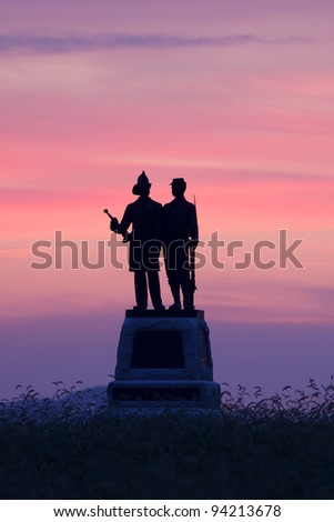 Foggy sunrise behind the 73rd New York Infantry Monument at the Gettysburg National Military Park in Pennsylvania,USA. - stock photo