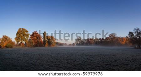 foggy sunrise in autumn - scenic view - stock photo
