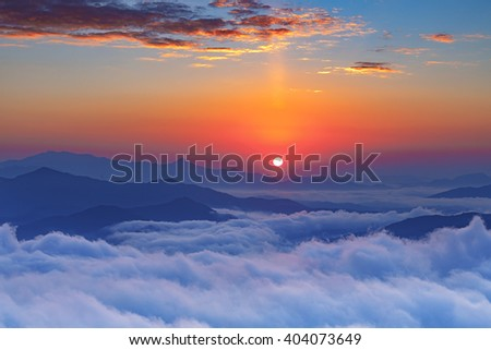 Foggy Sunrise morning in the mountains South Korea. - stock photo