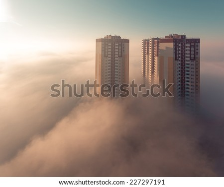 Foggy urban scene Thick fog in the morning covering a residential district. Kiev. Ukraine. - stock photo