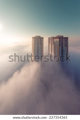 Foggy urban scene. Thick fog in the morning covering a residential district. Kiev. Ukraine. - stock photo