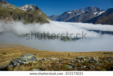 Foggy valley in the mountens, Schwarzsee, Zermatt - stock photo