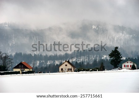 Foggy weather in high mountains, winter, Alsace France - stock photo