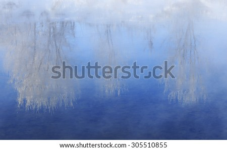 foggy winter landscape frosty morning over the river and trees in hoarfrost on the shores of - stock photo
