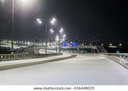 foggy winter night on the highway in the night the light of lanterns. Russia, Moscow