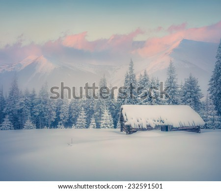 Foggy winter sunrise in mountains. Old ranch after huge snowfall. Retro style. - stock photo