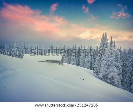 Foggy winter sunrise in mountains. Retro style. - stock photo