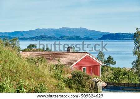 Fogn, Norway   July 17, 2015: Sea View, Red House On The