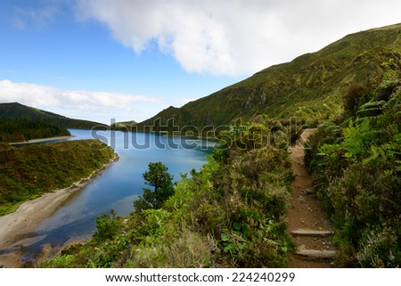 Fogo Lagoon on the island of Sao Miguel, Azores, Portugal. Amazing landscape taken in the paradise on earth. Lake formed in volcanic crater. Typical viewpoint of the Azores  - stock photo