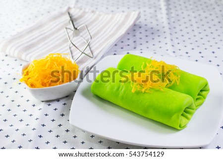 FOI thong crepes cake on white plate
