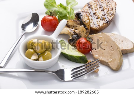 foie gras with grilled and fresh vegetables on plate served and decorated