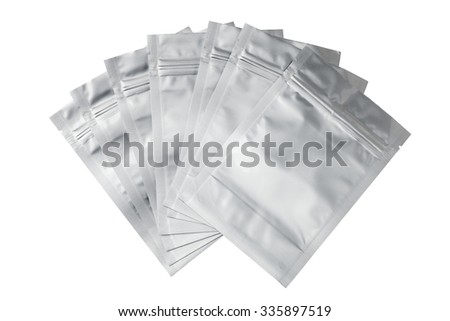 Foil food bags packaging with value and seal, Isolated on white. - stock photo
