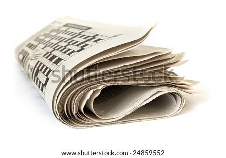 Fold up newspaper isolated on white background - stock photo