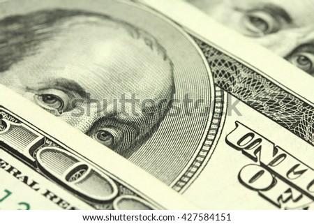 folded bills of one hundred dollars amerianskih abstract background - stock photo