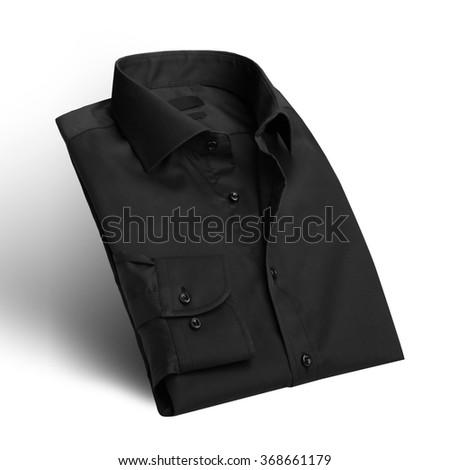 Folded Black shirt - stock photo