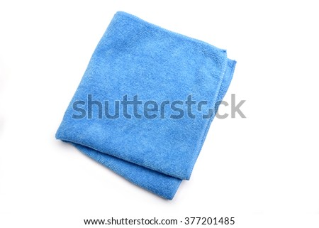 Folded blue microfiber cleaning cloth on a white background