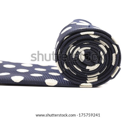 Folded blue tie with white speck. Isolated on a white background. - stock photo
