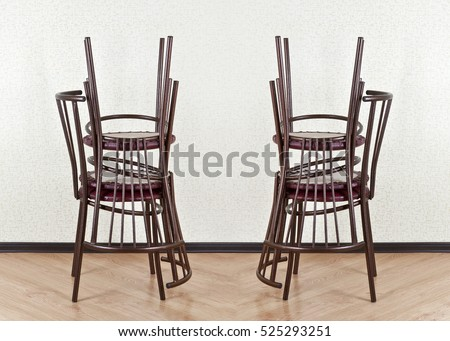 Folded chairs against the wall in an empty room
