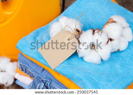 folded clothes with cotton raw buds and empty tag  isolated on white background - stock photo