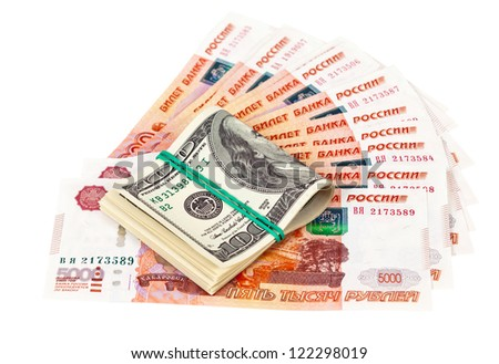 Folded dollar bills laying over rouble background - stock photo