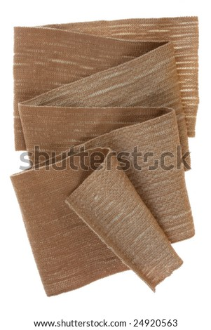 folded elastic medical bandage isolated on white